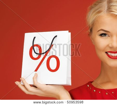 holidays, sale, christmas and shopping concept - woman holding bag with percent sign