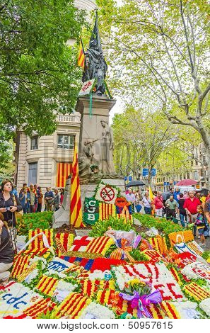 BARCELONA, SPAIN - SEPTEMBER 11: Catalan people participate in floral offerings to the monument of Rafael Casanova during the National Day of Catalonia, Barcelona, Spain on September 11, 2013