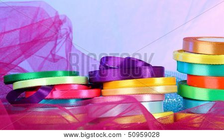 Bright ribbons on bright background