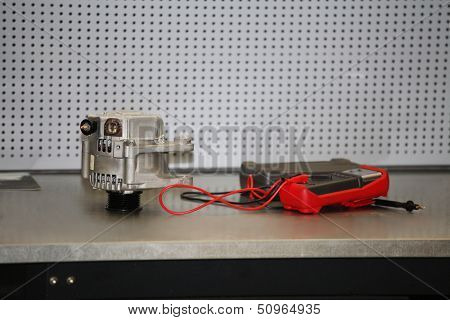 Generator and electric tester on a workbench