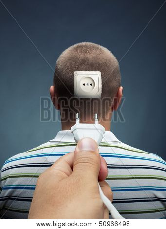 Plugging electrical cable into the outlet in head
