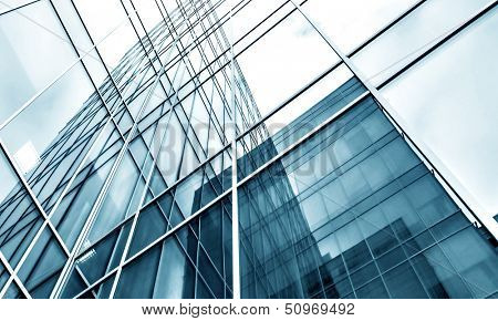 Modern black and blue glass silhouettes of building skyscrapers. Business concept of successful industrial solid and steel architecture background texture