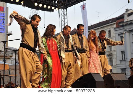 ZAGREB,CROATIA - JULY 17: Members of Music Society Payiz from Kurdistan, Iraq in Kurdish national costume during the 47th International Folklore Festival in center of Zagreb, Croatia on July 17,2013