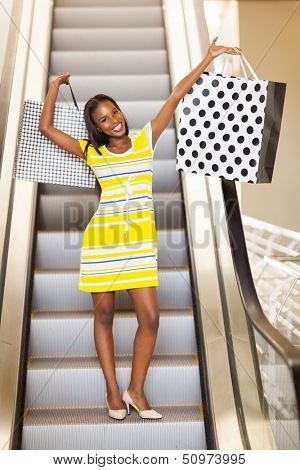 cheerful african woman in shopping mall