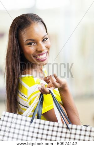 beautiful african woman shopping spree in mall