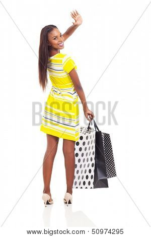cheerful african shopper waving goodbye isolated on white