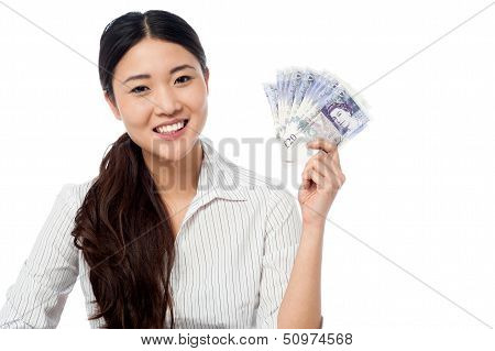 Pretty Woman Holding A Fan Of Currency Notes