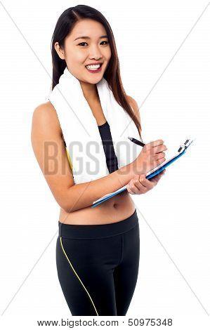 Female Dietitian Preparing Diet Chart