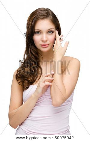 Half-length portrait of woman with hair ringlets touching her face, isolated on white. Concept of beauty and youth