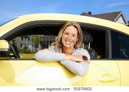 Young beautiful woman car driver in a new auto.