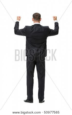 Full-length backview portrait of businessman with fists up, isolated on white. Concept of leadership and success
