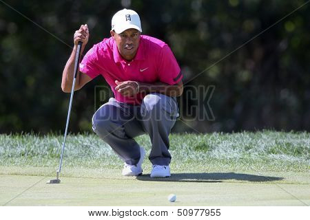 Sep 15, 2013; Lake Forest, IL, USA; Tiger Woods lines up a putt on the third green during the third round of the BMW Championship at Conway Farms Golf Club.