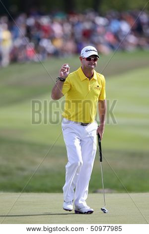 Sep 15, 2013; Lake Forest, IL, USA; Rory Sabbatini waves to the crowd after putting the 18th green during the third round of the BMW Championship at Conway Farms Golf Club.