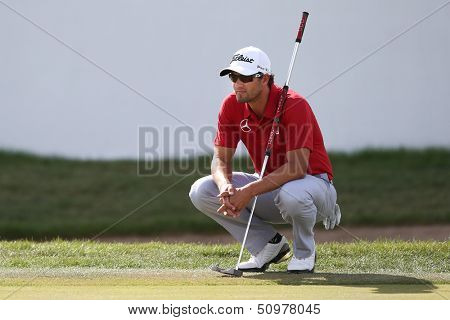 Sep 15, 2013; Lake Forest, IL, USA; Adam Scott waits on the 18th green during the third round of the BMW Championship at Conway Farms Golf Club.