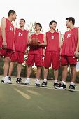 Basketball team standing and smiling, portrait