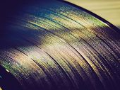 stock photo of analogy  - Vintage looking Vinyl record vintage analog music recording medium