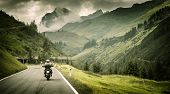 stock photo of cold-weather  - Motorcyclist on mountainous highway - JPG