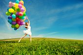 stock photo of balloon  - Happy birthday woman against the sky with rainbow - JPG