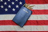 stock photo of evangelism  - King James Bible surrounded by bullets with American Flag as the background - JPG