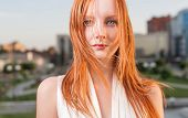 image of freckle face  - Portrait of freckled young woman over cityscape - JPG