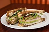 pic of deli  - A deli classic turkey sandwich with avocado on rye bread - JPG