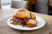 picture of veggie burger  - Detail of vegetarian falafel burger in restaurant - JPG