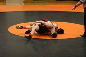 image of battle  - Two men battle for control in wrestling match - JPG