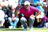 Sep 15, 2013; Lake Forest, IL, USA; Tiger Woods lines up a putt on the second green during the third