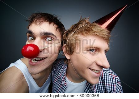 Two funny guys making faces at camera celebrating fools day