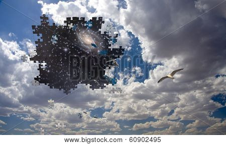 Puzzle piece daytime sky reveals night sky  Elements of this image furnished by NASA