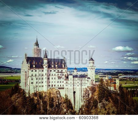 Vintage retro hipster style travel image of Famous Bavarian landmark - Neuschwanstein Castle (Schloss Neuschwanstein). Bavaria, Germany