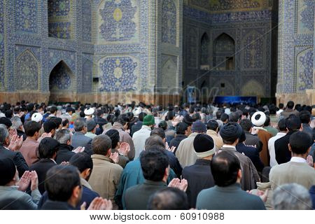 ISFAHAN, IRAN - NOVEMBER 30, 2007: Muslim Friday mass prayer in Imam Mosque (Jameh Abbasi Mosque)