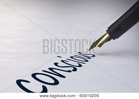 Fountain pen writing the word conscious