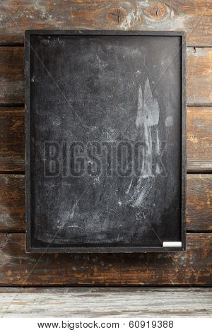 Black chalkboard with smudges and white chalk