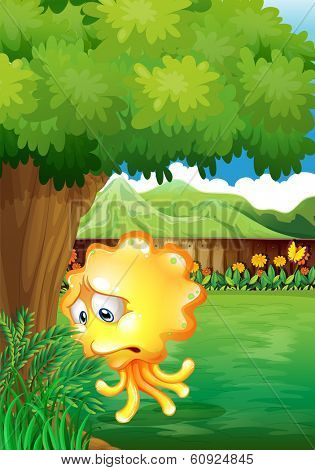 Illustration of a sad yellow monster under the tree