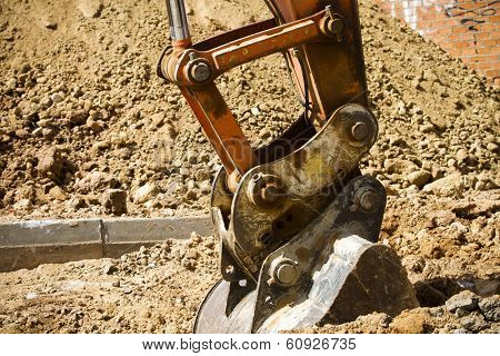 Excavator digging a deep trench, working