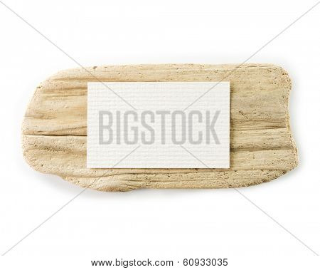 Flat piece of driftwood, with blank paper message area on top, isolated on white.