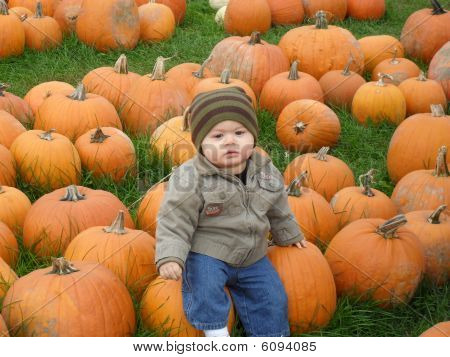 Young boy with a pumpkin