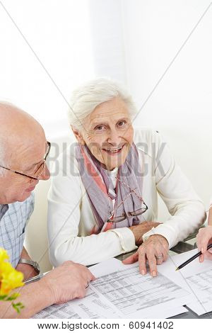 Senior couple planning insurance and taxes at the table