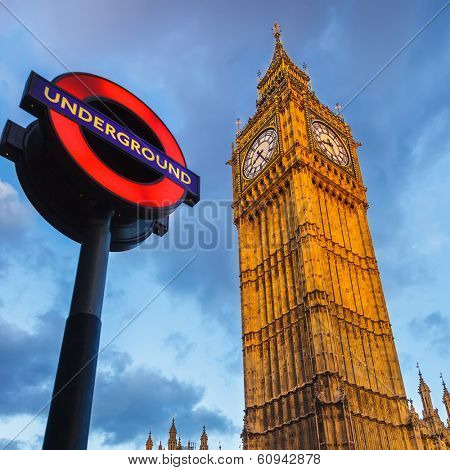 LONDON - MAY 08 2009:  The London 'Underground' sign and 'Big Ben' tower at evening on May 08 2009 in London. The Underground serves 270 stations and has 402 kilometres of track.