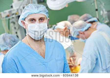 Male surgeon in uniform in front of cardiac surgery operation room at clinic
