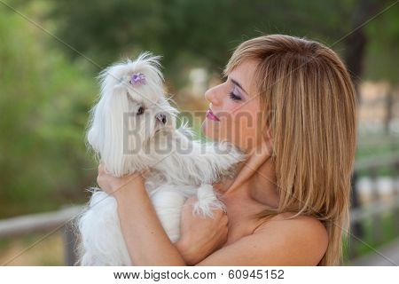 woman with family pet Maltese dog