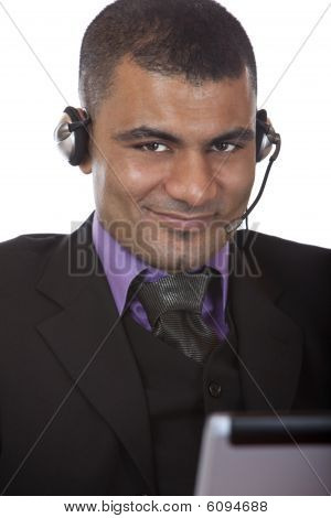 Young Male Call Center Agent With Headset