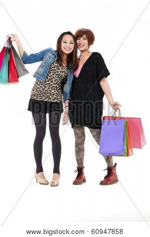 Full portrait of Asian girls standing with shopping bags