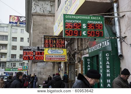 MOSCOW, RUSSIA - MARCH 04, 2014: Electronic board - daily exchange rate. Prices for cash currency in Russia once again set record. 1 U.S. dollar is now worth 36,98 ruble, and 1 euro - 50,97 ruble