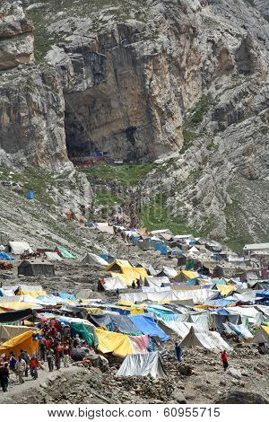 AMARNATH, JAMMU & KASHMIR, INDIA - JULY 18, 2006: Holy Amarnath Cave in Kashmir Himalays. It is a Hindu shrine dedicated to Shiva. It is considered to be one of the holiest shrines in Hinduism