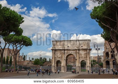 ROME - OCT 17 2012: Tourists walking near Constantine's arc in Rome - triumphal arch in Rome, situated between the Colosseum and the Palatine Hill