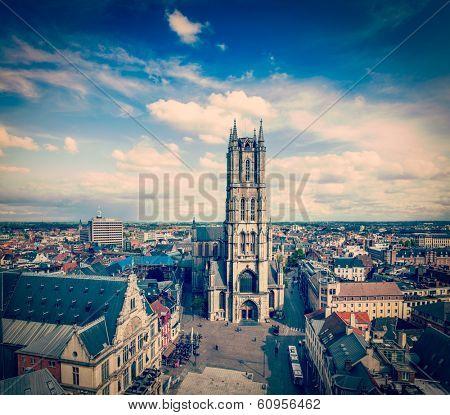 Vintage retro hipster style travel image of Saint Bavo Cathedral (Sint-Baafskathedraal) and Sint-Baafsplein, view from Belfry. Ghent, Belgium