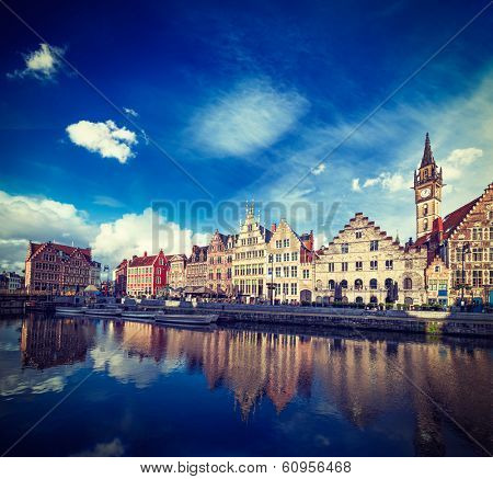 Vintage retro hipster style travel image of Europe Belgium medieval town travel background - Ghent canal and Graslei street on sunset. Ghent, Belgium