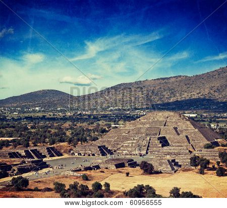 Vintage retro hipster style travel image of famous Mexico landmark tourist attraction - Pyramid of the Moon, view from the Pyramid of the Sun. Teotihuacan, Mexico with grunge texture overlaid